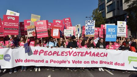 People hold placards and march to demand a people's vote against Brexit. (Photo by John Keeble/Gett