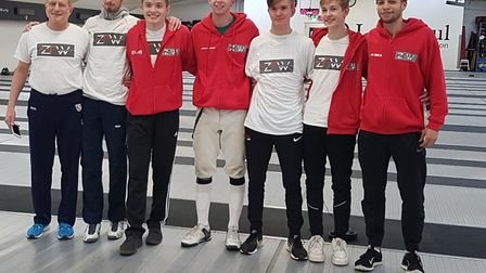 ZFW men's fencing squad and coaches after the men's foilists claimed half the spots in the final eig