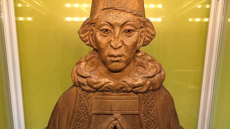 A wood carving of Sir Christopher Urswick in the Urswick School's musuem