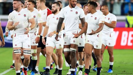 England's Courtney Lawes (centre), Anthony Watson (right) and team-mates walk off after the 2019 Rug