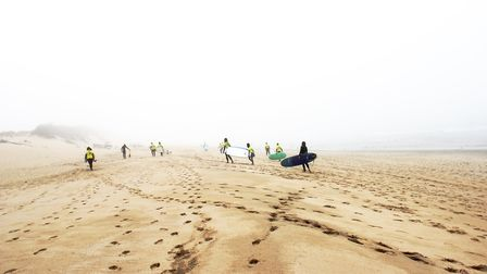 Carrying back the surf boards at the end of a lesson. Picture: iSurf Portugal