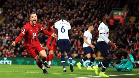 Liverpool's Jordan Henderson celebrates scoring his side's first goal of the game during the Premier