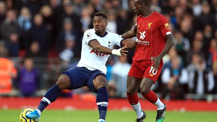 Tottenham Hotspur's Serge Aurier (left) and Liverpool's Sadio Mane battle for the ball during the Pr