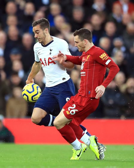 Tottenham Hotspur's Harry Winks (left) and Liverpool's Andrew Robertson battle for the ball during t