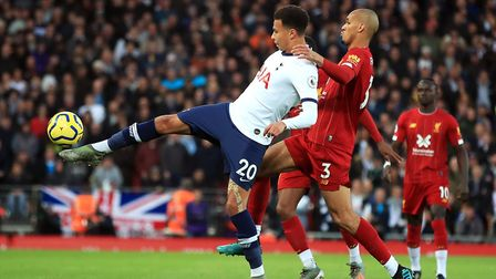 Tottenham Hotspur's Dele Alli (left) and Liverpool's Fabinho battle for the ball during the Premier