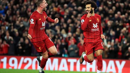 Liverpool's Mohamed Salah (right) celebrates scoring his side's second goal of the game from the pen