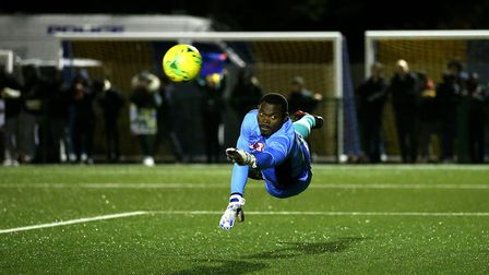 Haringey Borough goalkeeper Valery Pajetat dives for the ball during the FA Cup fourth qualifying ro