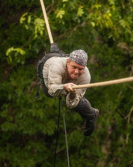 Mark Westcott doing the manilla rope crawl for the Bear Grylls show Mission Survive