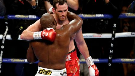 Dereck Chisora (left) and David Price embrace after the inter-continental heavyweight championship a