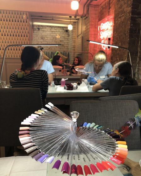 The Shoreditch salon is bang on trend, with distressed brick walls and swanky furniture. Picture: Em