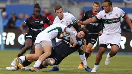Saracens' Duncan Taylor is tackled by London Irish's Tom Stephenson (left) during the Gallagher Prem