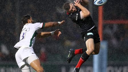 Saracens' Matt Gallagher (right) attempts to claim a high ball ahead of London Irish's Curtis Rona d