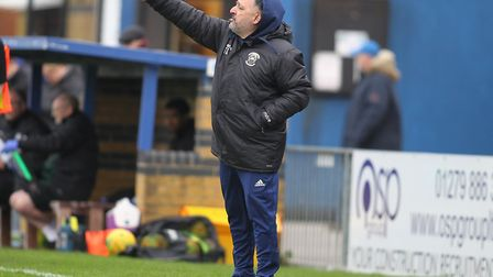 Tom Loizou gives instructions to his Haringey Borough team (pic: George Phillipou/TGS Photo).