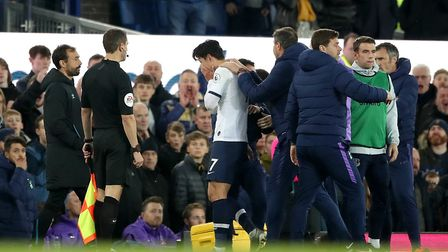 Tottenham Hotspur's Son Heung-min is sent off for a challenge on Everton's Andre Gomes during the Pr