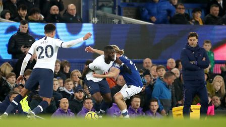 Tottenham Hotspur's Tanguy Ndombele (left centre) battles with Everton's Tom Davies as Tottenham Hot