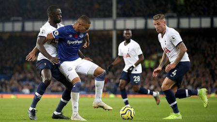 Everton's Richarlison (centre) holds off Tottenham Hotspur's Davinson Sanchez (left) during the Prem