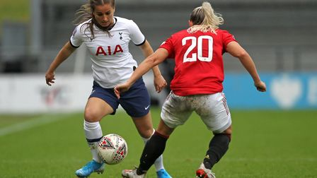 Manchester United's Kirsty Smith (right) and Tottenham Hotspur's Kit Graham battle for the ball duri
