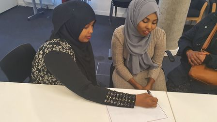 Shukri (left) volunteers her time to help people in the borough with everyday tasks and activities t