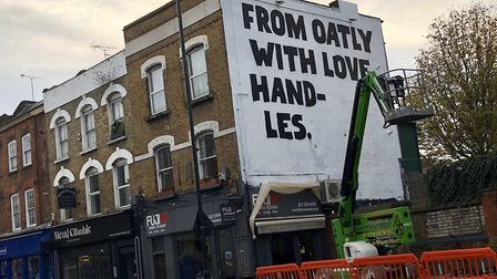 The advert being erected in Stoke Newington Church Street on Sunday. Picture: @StokeyUpdates