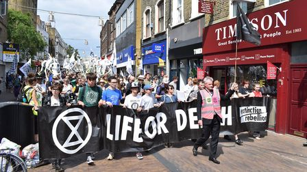 """Extinction Rebellion demonstrators """"skeleton march"""" through Hackney Downs to London Fields. Picture:"""