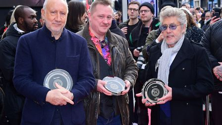 The Who's Pete Townshend and Roger Daltrey with Christopher Entwistle during the Music Walk of Fame