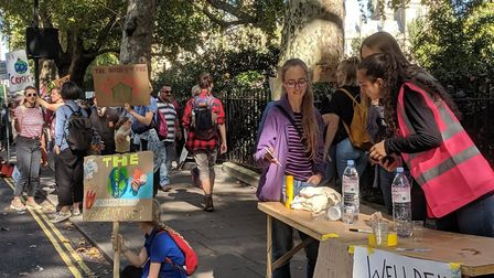 Anya Ramamurthy gives out water during the climate school strikes. Picture: Anya Ramamurthy