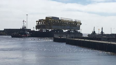 Dozens gathered as major components for an offshore gas rig departed Lowestoft Harbour. Picture: Tho