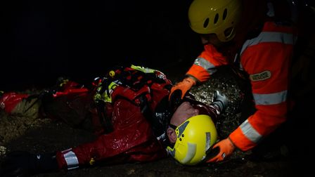 A London Search and Rescue volunteer helps treat a mock casualty who was struggling in one of the He