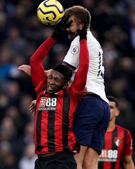 Bournemouth's Jefferson Lerma (left) and Tottenham Hotspur's Eric Dier battle for the ball