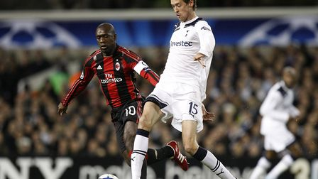 AC Milan's Clarence Seedorf (left) and Tottenham Hotspur's Peter Crouch (right) battle for the ball