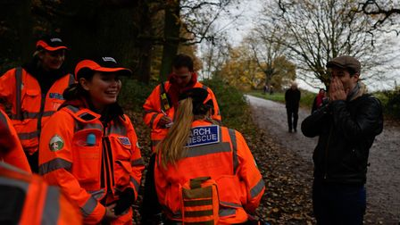 Rob Delaney and two of his children are met by Search and Rescue volunteers after an abandoned buggy