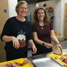 Simon Community volunteers serving food at their weekly evening centre for rough sleepers. Picture: