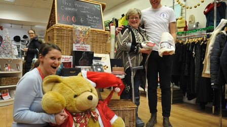 Shelter in Crouch End's Christmas Raffle. Rosie Andrews holding Santa Paws the teddy, Victoria Vicke