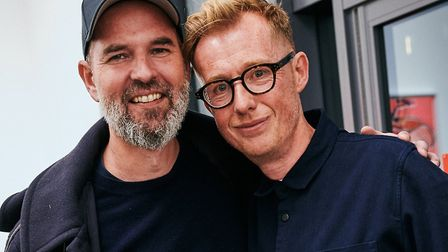 Ben Cotton (right) with artist Tim Fishlock at the new-look Hang-Up Gallery. Picture: Chuck Noble.