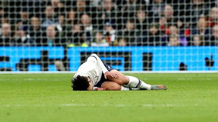 Tottenham Hotspur's Son Heung-min lies on the pitch with an injury during the Premier League match a