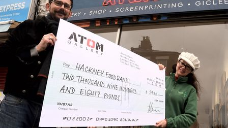 Richard Pendry of Atom Gallery giving Melanie Rochford of Hackney foodbank a cheque for �2980. Pictu