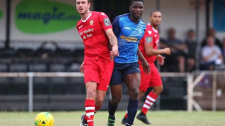 Matt Johnson of Hornchurch and Olu Oluwatimilehin of Wingate during Hornchurch vs Wingate & Finchley