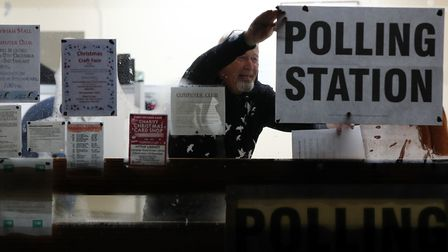 A polling station is set-up as voters go to the polls. Photograph: Gareth Fuller/PA Wire.