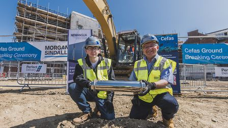 The time capsule being buried at the Cefas ground-breaking ceremony. Picture: Darren Carter.