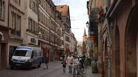 People go about their business in Strasbourg, where the EU parliament opened in 1999.