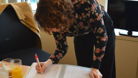 Luisa Porritt signs a motion condemning Iran for its treatment of protesters. Picture: Harry Taylor