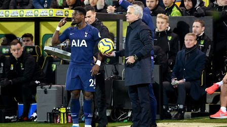 Tottenham Hotspur's Serge Aurier (left) goes to retrieve the ball from manager Jose Mourinho during