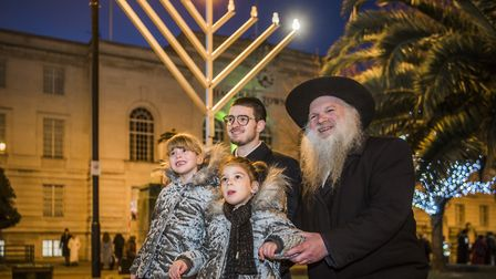 Rabbi Herschel Gluck next to the specially built 12ft menorah in the Town Hall Square. Picture: Hack