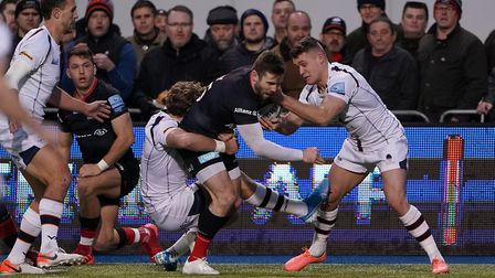 Saracens Elliot Daly is tackled during the Gallagher Premiership match at Allianz Park, London.