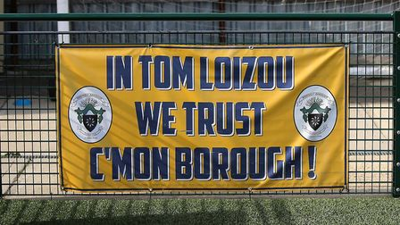 A banner in support of Haringey Borough manager Tom Loizou is seen at Coles Park (pic George Phillip