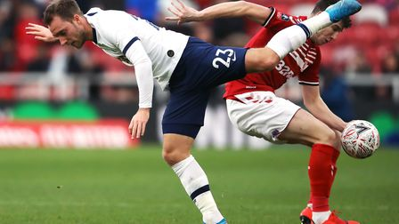 Tottenham Hotspur's Christian Eriksen (left) and Middlesbrough's Paddy McNair battle for the ball du