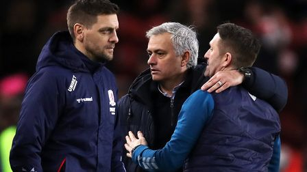 Tottenham Hotspur manager Jose Mourinho (centre) embraces Middlesbrough manager Jonathan Woodgate (l