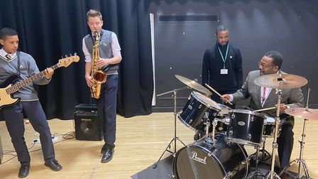 Actor Wendell Pierce on the drums during a visit to Haggerston School.