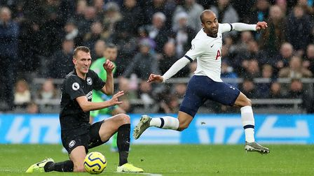 Brighton and Hove Albion's Dan Burn (left) and Tottenham Hotspur's Lucas Moura battle for the ball