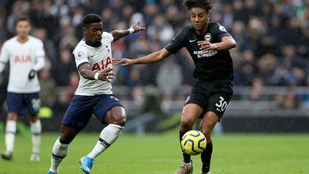 Tottenham Hotspur's Serge Aurier (left) and Brighton and Hove Albion's Bernardo battle for the ball